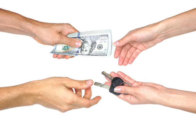 Hand with money and keys