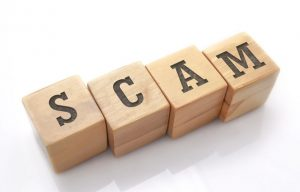 scam spelt out on letter blocks to illustrate scam calls