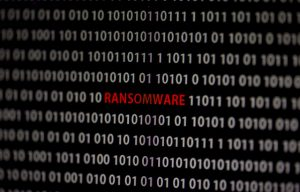 The word ransomware surrounded by code to illustrate story on WannaCry