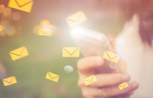 Envelope icons emanating out of a smartphone to illustrate story on Infosecurity Europe