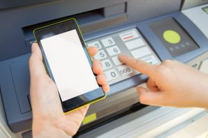 A smartphone used to access the information linked to an ATM